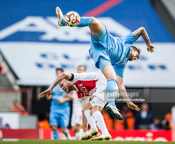 Marco Russ of Frankfurt jumps for a header with Kevin Vogt of Koeln during the Bundesliga match between 1 FC Koeln and Eintracht Frankfurt at...