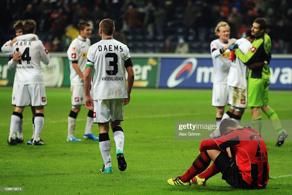 Marco Russ (front) of Frankfurt reacts as players of M'Gladbach celebrate after the Bundesliga match between Eintracht Frankfurt and Borussia M'gladbach at Commerzbank Arena on January 30, 2011 in Frankfurt am Main, Germany.