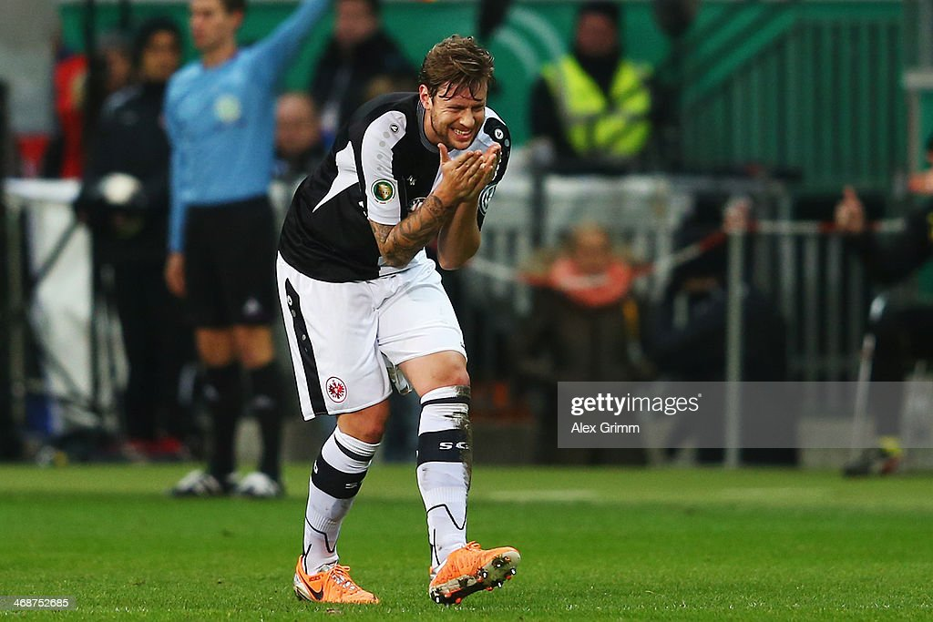 Marco Russ of Frankfurt reacts during the DFB Cup quarterfinal match between Eintracht Frankfurt and Borussia Dortmund at Commerzbank-Arena on February 11, 2014 in Frankfurt am Main, Germany.