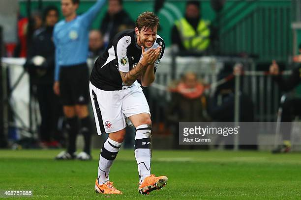 Marco Russ of Frankfurt reacts during the DFB Cup quarterfinal match between Eintracht Frankfurt and Borussia Dortmund at CommerzbankArena on...