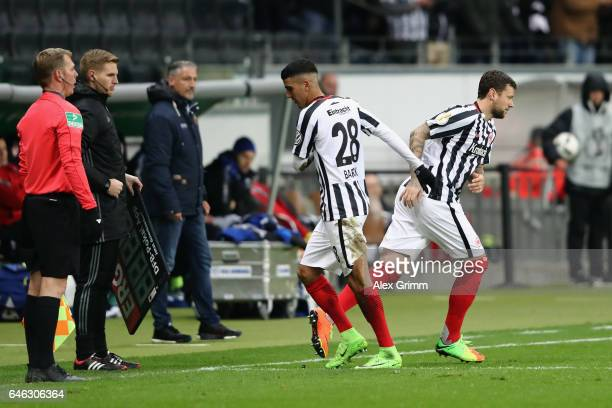 Marco Russ of Frankfurt replaces Aymane Barkok during the DFB Cup quarter final between Eintracht Frankfurt and Arminia Bielefeld at Commerzbank...