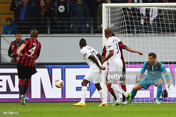 Marco Russ of Frankfurt scores his team's second goal against goalkeeper Cedric Carrasso of Bordeaux during the UEFA Europa League Group F match...