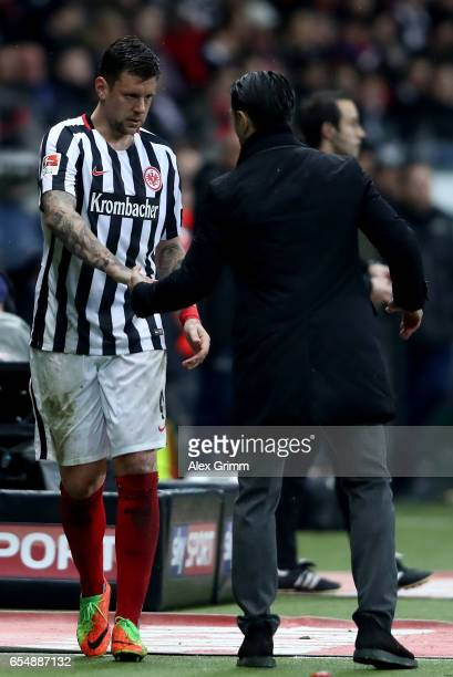 Marco Russ of Frankfurt shakes hands with head coach Niko Kovac during the Bundesliga match between Eintracht Frankfurt and Hamburger SV at...