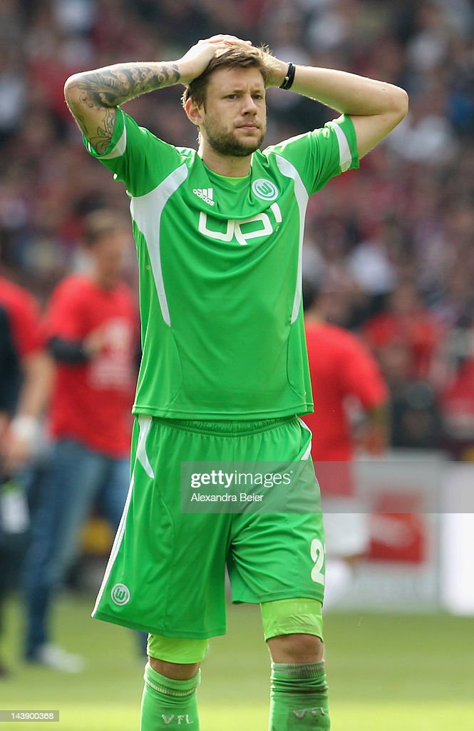 Marco Russ of Wolfsburg reacts after his team's loss of the Bundesliga match between VfB Stuttgart and VfL Wolfsburg at Mercedes-Benz Arena on May 5, 2012 in Stuttgart, Germany.