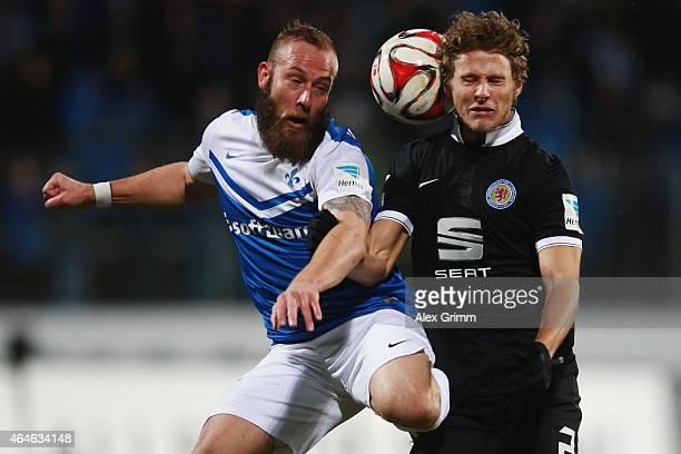 Marco Sailer of Darmstadt is challenged by Vegar Hedenstad of Braunschweig during the Second Bundesliga match between SV Darmstadt 98 and Eintracht...