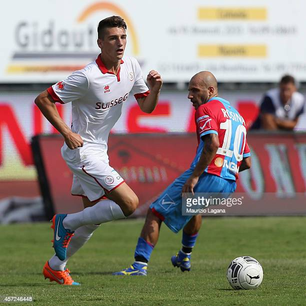 Marco Salviato of AS Bari is challenged by Alessandro Rosina of Catania during the Serie B match between Catania Calcio and AS Bari at Stadio Angelo...