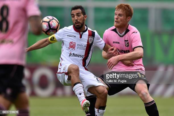 Marco Sau of Cagliari and Alessandro Gazzi of Palermo in action during the Serie A match between US Citta di Palermo and Cagliari Calcio at Stadio...