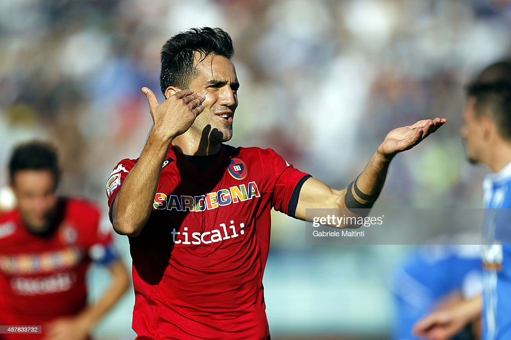 <a gi-track='captionPersonalityLinkClicked' href=/galleries/search?phrase=Marco+Sau&family=editorial&specificpeople=8343246 ng-click='$event.stopPropagation()'>Marco Sau</a> of Cagliari Calcio celebrates after scoring a goal during the Serie A match between Empoli FC and Cagliari Calcio at Stadio Carlo Castellani on October 25, 2014 in Empoli, Italy.