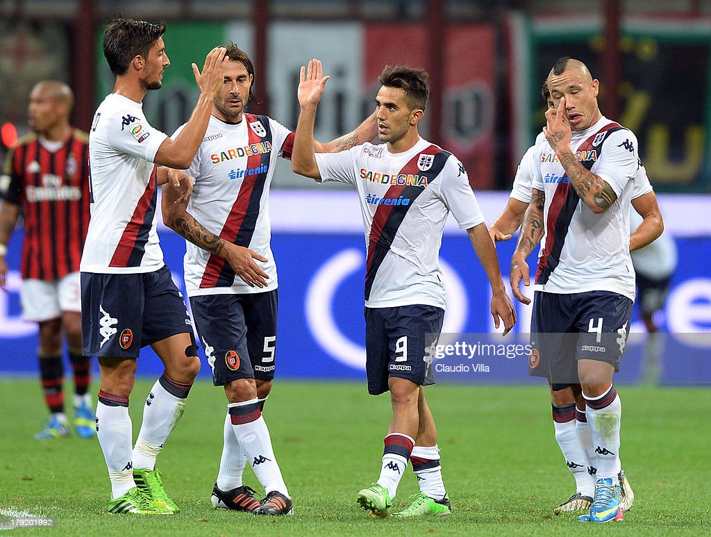 Marco Sau #9 of Cagliari Calcio celebrates with team-mates after scoring his team's first goal during the Serie A match between AC Milan and Cagliari Calcio at San Siro Stadium on September 1, 2013 in Milan, Italy.