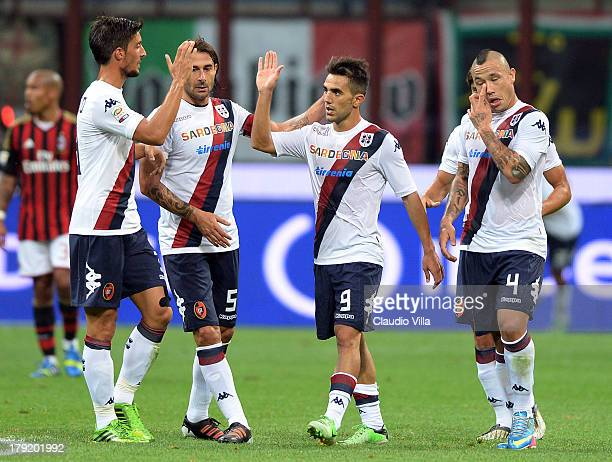 Marco Sau of Cagliari Calcio celebrates with teammates after scoring his team's first goal during the Serie A match between AC Milan and Cagliari...