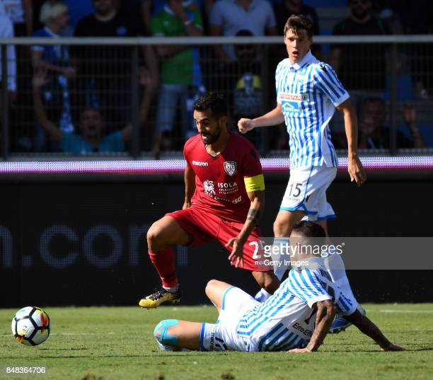 Marco Sau of Cagliari Calcio competes for the ball whit Federico Viviani of Spal during the Serie A match between Spal and Cagliari Calcio at Stadio...