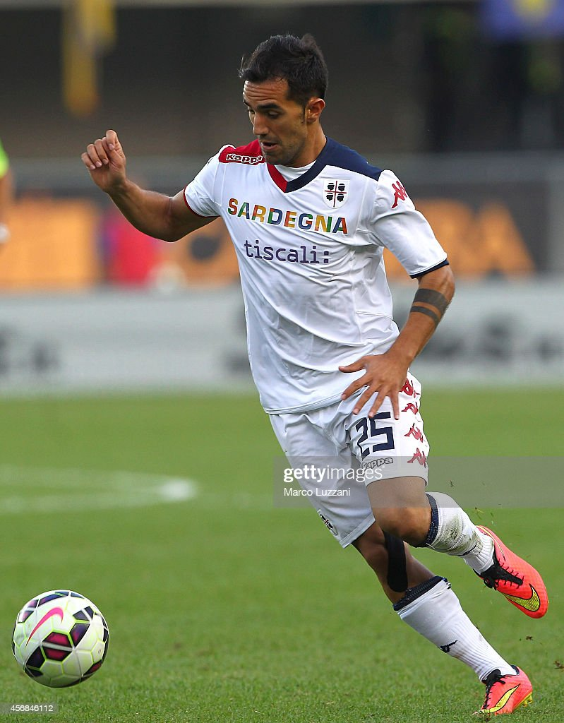 <a gi-track='captionPersonalityLinkClicked' href=/galleries/search?phrase=Marco+Sau&family=editorial&specificpeople=8343246 ng-click='$event.stopPropagation()'>Marco Sau</a> of Cagliari Calcio in action during the Serie A match between Hellas Verona FC and Cagliari Calcio at Stadio Marc'Antonio Bentegodi on October 4, 2014 in Verona, Italy.