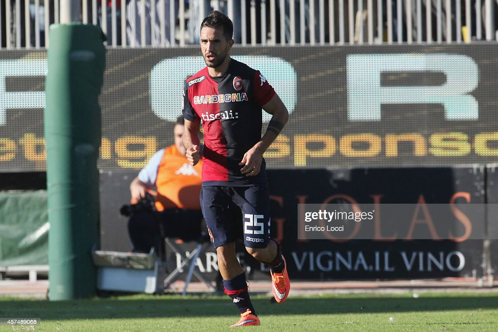 <a gi-track='captionPersonalityLinkClicked' href=/galleries/search?phrase=Marco+Sau&family=editorial&specificpeople=8343246 ng-click='$event.stopPropagation()'>Marco Sau</a> of Cagliari celebrates after scoring their second goal during the Serie A match between Cagliari Calcio and UC Sampdoria at Stadio Sant'Elia on October 19, 2014 in Cagliari, Italy.