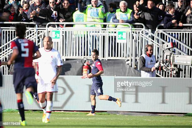 Marco Sau of Cagliari celebrates with the teammates after scoring the opening goal during the Serie A match between Cagliari Calcio and AC Milan at...