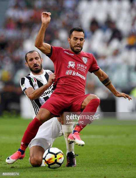 Marco Sau of Cagliari competes for the ball with Giorgio Chiellini of Juventus during the Serie A match between Juventus and Cagliari Calcio at...