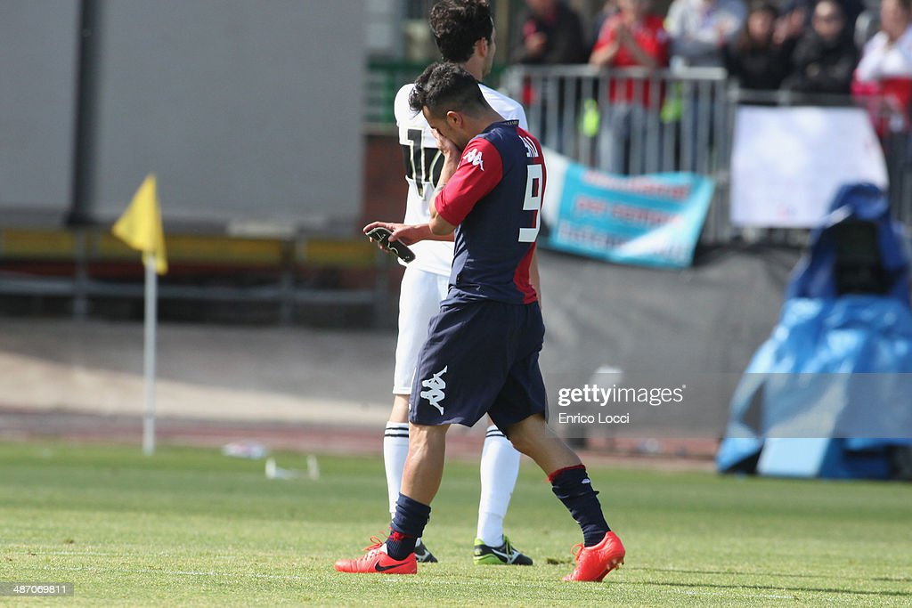 <a gi-track='captionPersonalityLinkClicked' href=/galleries/search?phrase=Marco+Sau&family=editorial&specificpeople=8343246 ng-click='$event.stopPropagation()'>Marco Sau</a> of Cagliari during the Serie A match between Cagliari Calcio and Parma FC at Stadio Sant'Elia on April 27, 2014 in Cagliari, Italy.