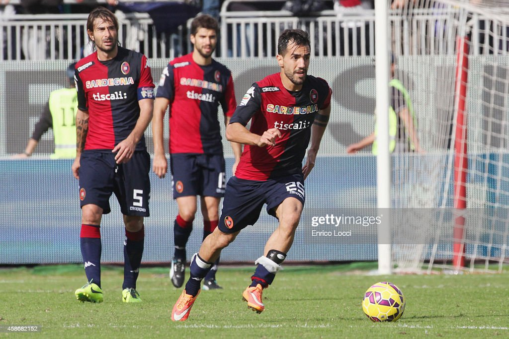 <a gi-track='captionPersonalityLinkClicked' href=/galleries/search?phrase=Marco+Sau&family=editorial&specificpeople=8343246 ng-click='$event.stopPropagation()'>Marco Sau</a> of CAgliari in action during the Serie A match between Cagliari Calcio and Genoa CFC at Stadio Sant'Elia on November 9, 2014 in Cagliari, Italy.