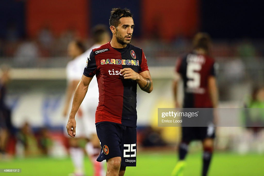 <a gi-track='captionPersonalityLinkClicked' href=/galleries/search?phrase=Marco+Sau&family=editorial&specificpeople=8343246 ng-click='$event.stopPropagation()'>Marco Sau</a> of Cagliari look on during the Serie A match between Cagliari Calcio and Torino FC at Stadio Sant'Elia on September 24, 2014 in Cagliari, Italy.