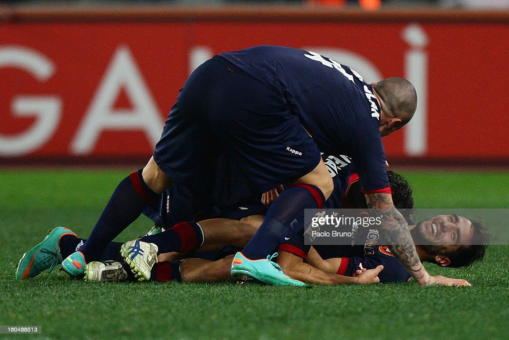 Marco Sau (R) with his teammates of Cagliari Calcio celebrates after scoring the third team's goal during the Serie A match between AS Roma and Cagliari Calcio at Stadio Olimpico on February 1, 2013 in Rome, Italy.