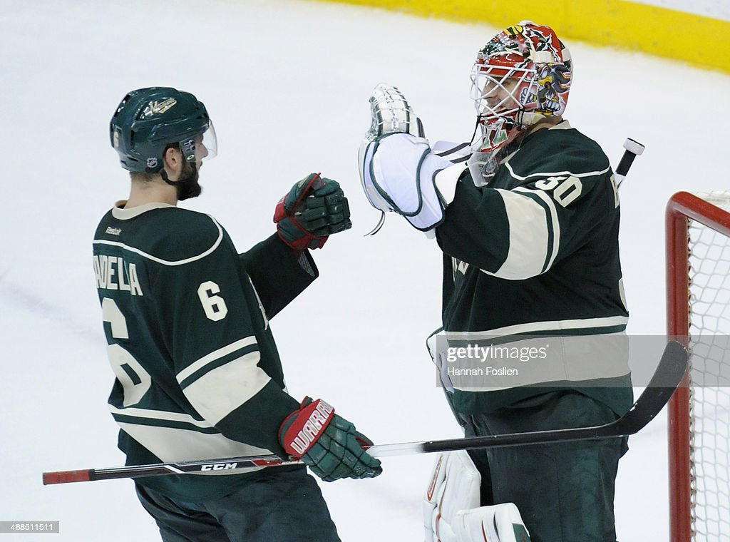 Marco Scandella #6 and Ilya Bryzgalov #30 of the Minnesota Wild celebrate a win of Game Three of the Second Round of the 2014 NHL Stanley Cup Playoffs against the Chicago Blackhawks on May 6, 2014 at Xcel Energy Center in St Paul, Minnesota. The Wild defeated the Blackhawks 4-0.
