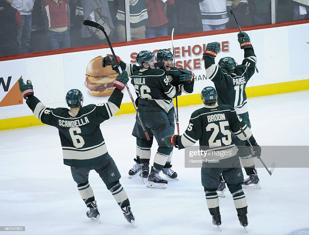 Marco Scandella #6, Erik Haula #56, Jason Pominville #29, Jonas Brodin #25 and Zach Parise #11 of the Minnesota Wild celebrate an empty net goal against the Colorado Avalanche during the third period in Game Six of the First Round of the 2014 NHL Stanley Cup Playoffs on April 28, 2014 at Xcel Energy Center in St Paul, Minnesota. The Wild defeated the Avalanche 5-2.