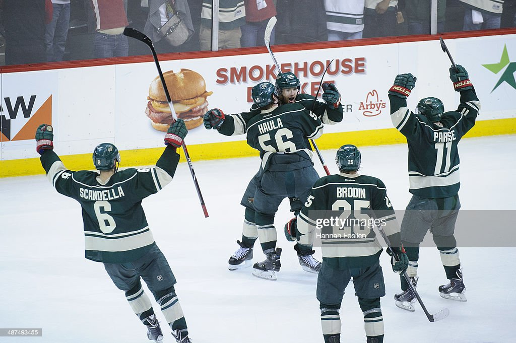 Marco Scandella #6, Erik Haula #56, Jason Pominville #29, Jonas Brodin #25, and Zach Parise #11 of the Minnesota Wild celebrate a goal by Pominville as Paul Stastny #26 of the Colorado Avalanche looks on in Game Six of the First Round of the 2014 NHL Stanley Cup Playoffs on April 28, 2014 at Xcel Energy Center in St Paul, Minnesota. The Wild defeated the Avalanche 5-2.