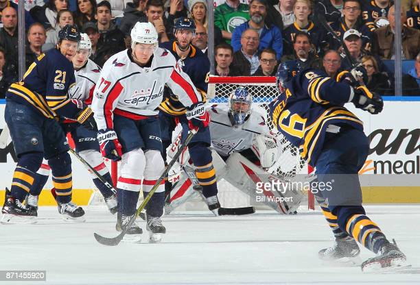Marco Scandella of the Buffalo Sabres fires a second period shot against TJ Oshie and Philipp Grubauer of the Washington Capitals during an NHL game...