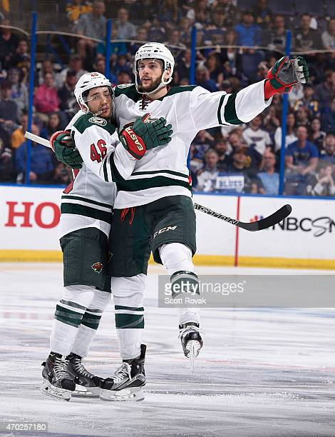 Marco Scandella of the Minnesota Wild celebrates with Jared Spurgeon after scoring a goal against the St Louis Blues in Game Two of the Western...