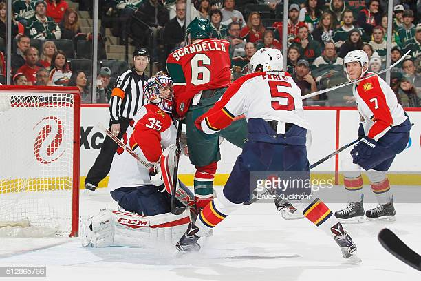 Marco Scandella of the Minnesota Wild is called for a goalie interference penalty after goalie with goalie Al Montoya and Aaron Ekblad of the Florida...