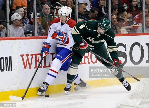 Marco Scandella of the Minnesota Wild pins Lars Eller of the Montreal Canadiens to the boards during the second period of the game on November 1 2013...