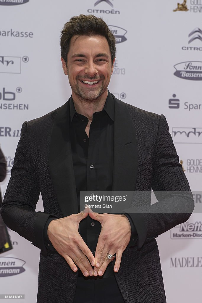 <a gi-track='captionPersonalityLinkClicked' href=/galleries/search?phrase=Marco+Schreyl&family=editorial&specificpeople=801195 ng-click='$event.stopPropagation()'>Marco Schreyl</a> arrives for the Goldene Henne 2013 award at Stage Theater on September 25, 2013 in Berlin, Germany.