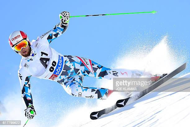 Marco Schwarz of Austria competes in the first run of the men's giant slalom of the FIS ski world cup in Soelden Austria on October 23 2016 / AFP /...