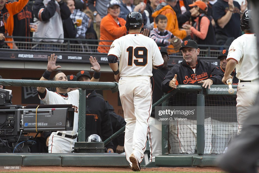 <a gi-track='captionPersonalityLinkClicked' href=/galleries/search?phrase=Marco+Scutaro&family=editorial&specificpeople=239523 ng-click='$event.stopPropagation()'>Marco Scutaro</a> #19 is congratulated by <a gi-track='captionPersonalityLinkClicked' href=/galleries/search?phrase=Bruce+Bochy&family=editorial&specificpeople=220291 ng-click='$event.stopPropagation()'>Bruce Bochy</a> #15 of the San Francisco Giants (right) after scoring a run against the Los Angeles Dodgers during the third inning at AT&T Park on May 5, 2013 in San Francisco, California.