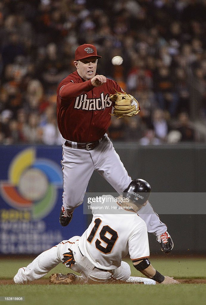 <a gi-track='captionPersonalityLinkClicked' href=/galleries/search?phrase=Marco+Scutaro&family=editorial&specificpeople=239523 ng-click='$event.stopPropagation()'>Marco Scutaro</a> #19 of the San Francisco Giants breaks up the double-play at second base, sliding under <a gi-track='captionPersonalityLinkClicked' href=/galleries/search?phrase=Aaron+Hill+-+Baseball+Player&family=editorial&specificpeople=239242 ng-click='$event.stopPropagation()'>Aaron Hill</a> #2 of the Arizona Diamondbacks in the fouth inning at AT&T Park on September 26, 2012 in San Francisco, California.