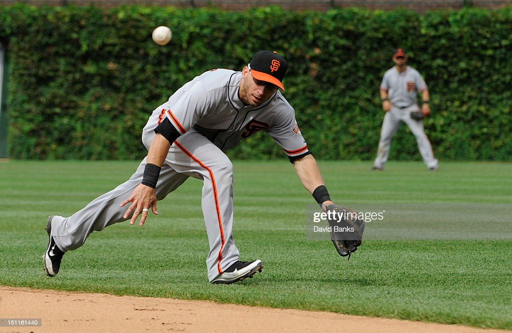 <a gi-track='captionPersonalityLinkClicked' href=/galleries/search?phrase=Marco+Scutaro&family=editorial&specificpeople=239523 ng-click='$event.stopPropagation()'>Marco Scutaro</a> #19 of the San Francisco Giants can't come with base hit in the fifth inning against the Chicago Cubs on September 02 2012 at Wrigley Field in Chicago, Illinois.