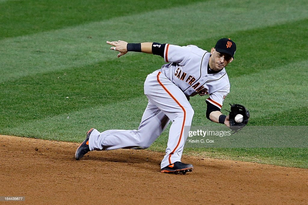 <a gi-track='captionPersonalityLinkClicked' href=/galleries/search?phrase=Marco+Scutaro&family=editorial&specificpeople=239523 ng-click='$event.stopPropagation()'>Marco Scutaro</a> #19 of the San Francisco Giants catches a line drive hit by Allen Craig #21 of the St. Louis Cardinals in the ninth inning in Game Five of the National League Championship Series at Busch Stadium on October 19, 2012 in St Louis, Missouri.