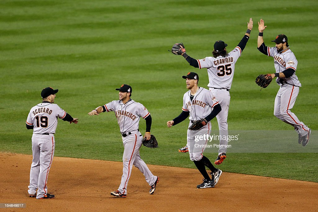 Marco Scutaro #19 of the San Francisco Giants celebrates with teammates Gregor Blanco #7, Hunter Pence #8, Brandon Crawford #35 and Angel Pagan #16 after defeating the Detroit Tigers in Game Three of the Major League Baseball World Series at Comerica Park on October 27, 2012 in Detroit, Michigan. The San Francisco Giants defeated the Detroit Tigers 2-0.