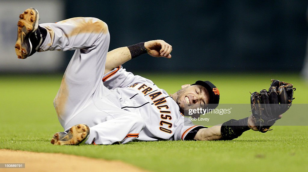 <a gi-track='captionPersonalityLinkClicked' href=/galleries/search?phrase=Marco+Scutaro&family=editorial&specificpeople=239523 ng-click='$event.stopPropagation()'>Marco Scutaro</a> #19 of the San Francisco Giants comes up short as he dives for a ball against the Houston Astros at Minute Maid Park on August 28, 2012 in Houston, Texas.