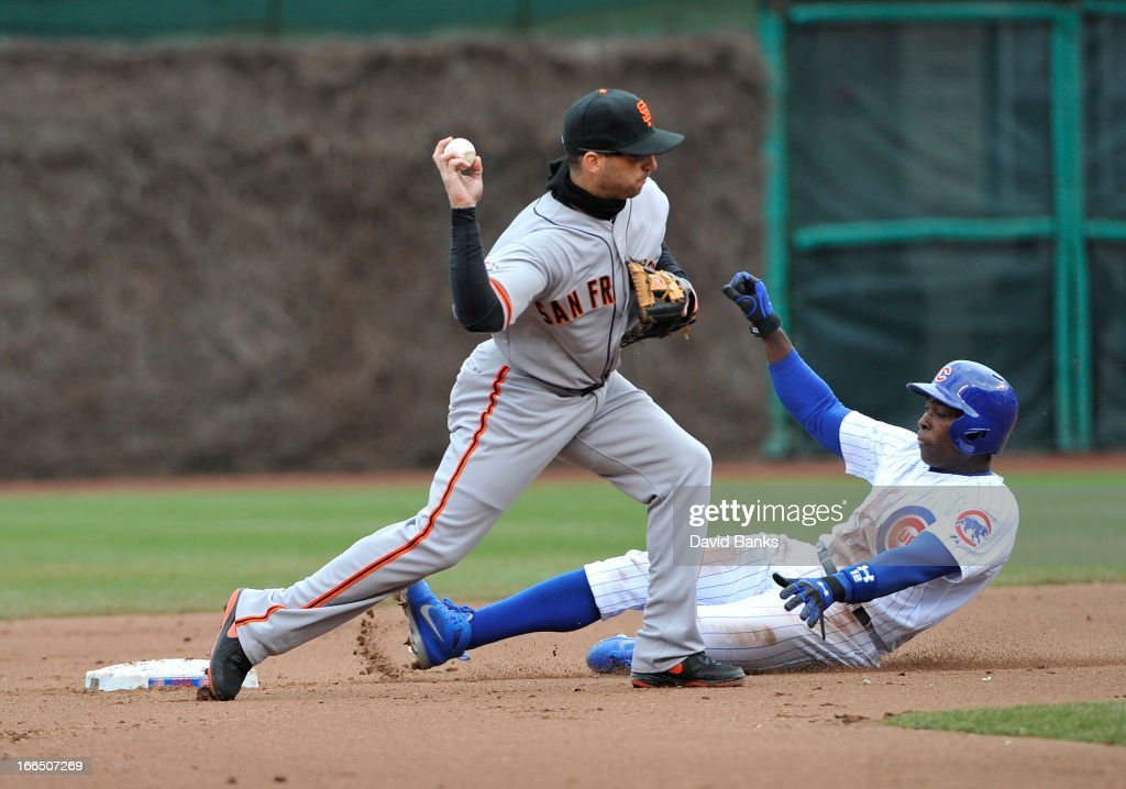 <a gi-track='captionPersonalityLinkClicked' href=/galleries/search?phrase=Marco+Scutaro&family=editorial&specificpeople=239523 ng-click='$event.stopPropagation()'>Marco Scutaro</a> #19 of the San Francisco Giants forces out <a gi-track='captionPersonalityLinkClicked' href=/galleries/search?phrase=Alfonso+Soriano&family=editorial&specificpeople=202251 ng-click='$event.stopPropagation()'>Alfonso Soriano</a> #12 of the Chicago Cubs at second base during the fourth inning on April 13, 2013 at Wrigley Field in Chicago, Illinois.