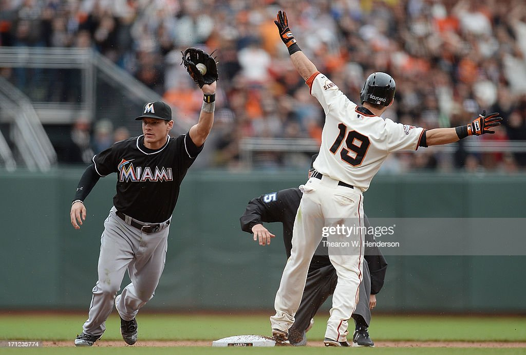 <a gi-track='captionPersonalityLinkClicked' href=/galleries/search?phrase=Marco+Scutaro&family=editorial&specificpeople=239523 ng-click='$event.stopPropagation()'>Marco Scutaro</a> #19 of the San Francisco Giants gets called out at second base as Derek Dietrich #51 shows the ball after the tag in the eighth inning at AT&T Park on June 23, 2013 in San Francisco, California.