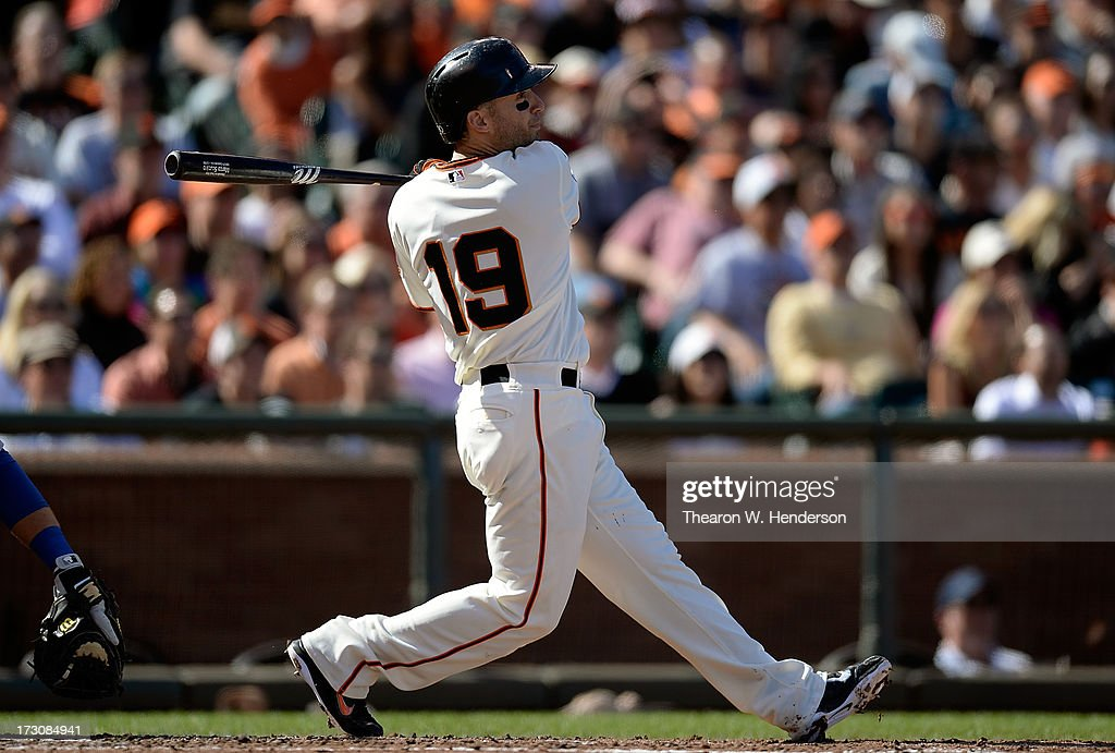 <a gi-track='captionPersonalityLinkClicked' href=/galleries/search?phrase=Marco+Scutaro&family=editorial&specificpeople=239523 ng-click='$event.stopPropagation()'>Marco Scutaro</a> #19 of the San Francisco Giants hits a sacrifice fly scoring Brandon Crawford #35 in the second inning against the Los Angeles Dodgers at AT&T Park on July 6, 2013 in San Francisco, California.