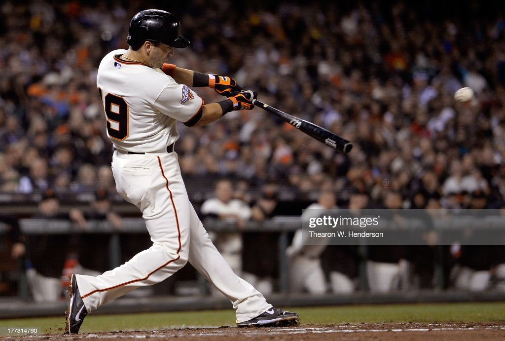 <a gi-track='captionPersonalityLinkClicked' href=/galleries/search?phrase=Marco+Scutaro&family=editorial&specificpeople=239523 ng-click='$event.stopPropagation()'>Marco Scutaro</a> #19 of the San Francisco Giants hits a two-run single, scoring Pablo Sandoval and Gregor Blanco (not pictured) in the fourth inning against the Pittsburgh Pirates at AT&T Park on August 22, 2013 in San Francisco, California.