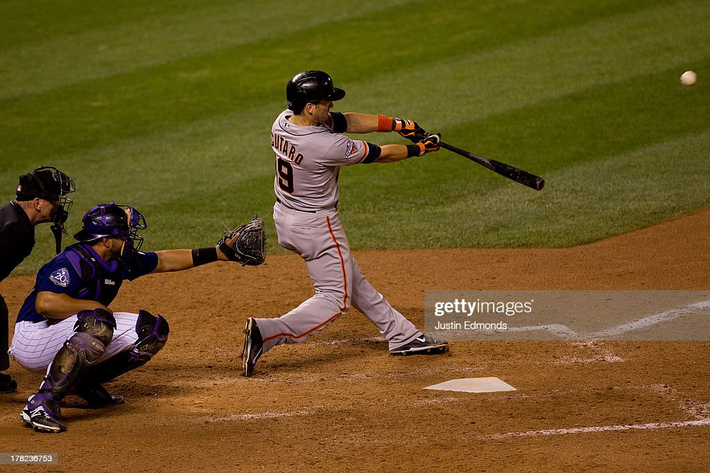 <a gi-track='captionPersonalityLinkClicked' href=/galleries/search?phrase=Marco+Scutaro&family=editorial&specificpeople=239523 ng-click='$event.stopPropagation()'>Marco Scutaro</a> #19 of the San Francisco Giants hits an RBI sacrifice fly during the seventh inning against the Colorado Rockies at Coors Field on August 27, 2013 in Denver, Colorado. The Giants defeated the Rockies 5-3.