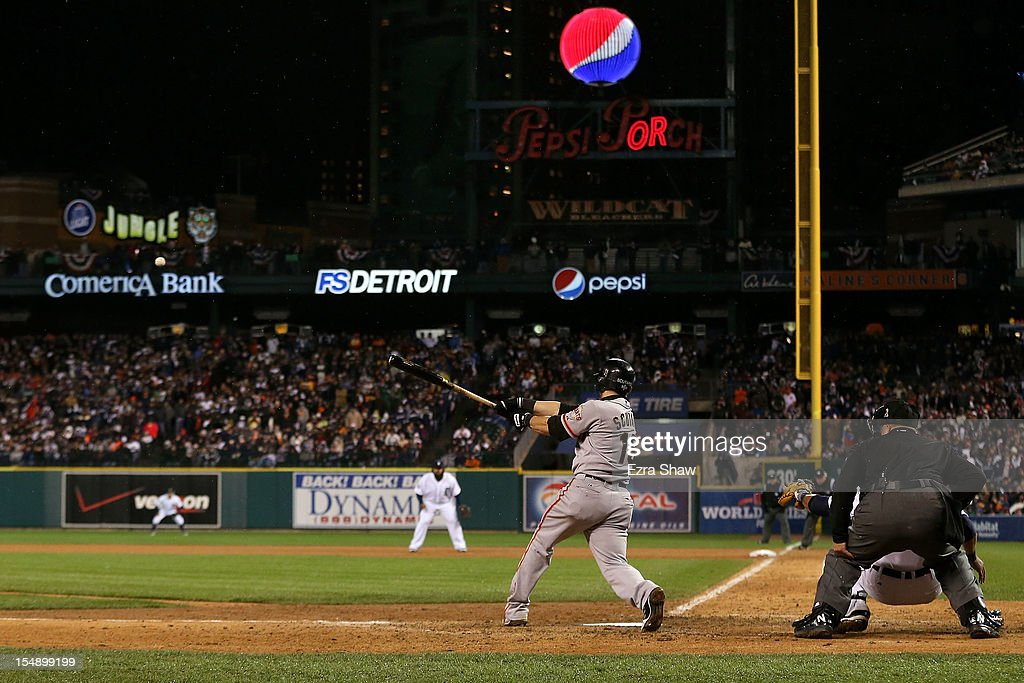 <a gi-track='captionPersonalityLinkClicked' href=/galleries/search?phrase=Marco+Scutaro&family=editorial&specificpeople=239523 ng-click='$event.stopPropagation()'>Marco Scutaro</a> #19 of the San Francisco Giants hits an RBI single against Phil Coke #40 of the Detroit Tigers in the tenth inning during Game Four of the Major League Baseball World Series at Comerica Park on October 28, 2012 in Detroit, Michigan.