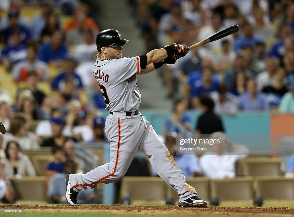 <a gi-track='captionPersonalityLinkClicked' href=/galleries/search?phrase=Marco+Scutaro&family=editorial&specificpeople=239523 ng-click='$event.stopPropagation()'>Marco Scutaro</a> #19 of the San Francisco Giants hits an RBI single to tie the score in the eighth inning against the Los Angeles Dodgers on October 1, 2012 at Dodger Stadium in Los Angeles, California.