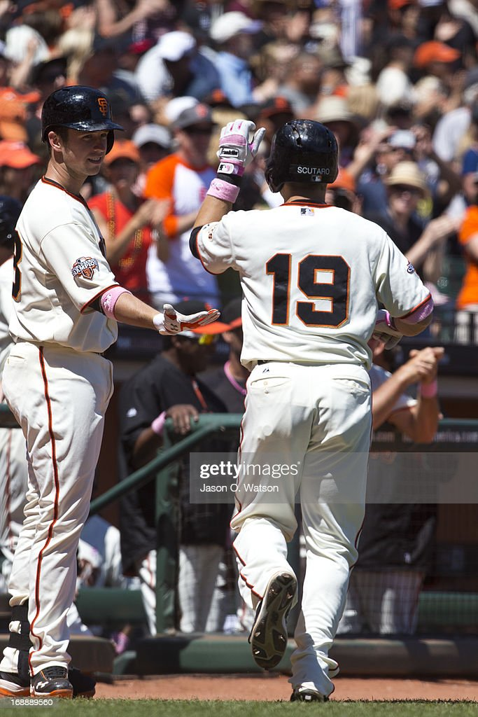 <a gi-track='captionPersonalityLinkClicked' href=/galleries/search?phrase=Marco+Scutaro&family=editorial&specificpeople=239523 ng-click='$event.stopPropagation()'>Marco Scutaro</a> #19 of the San Francisco Giants is congratulated by <a gi-track='captionPersonalityLinkClicked' href=/galleries/search?phrase=Buster+Posey&family=editorial&specificpeople=4896435 ng-click='$event.stopPropagation()'>Buster Posey</a> #28 after hitting a home run against the Atlanta Braves during the fifth inning at AT&T Park on May 12, 2013 in San Francisco, California. The San Francisco Giants defeated the Atlanta Braves 5-1.