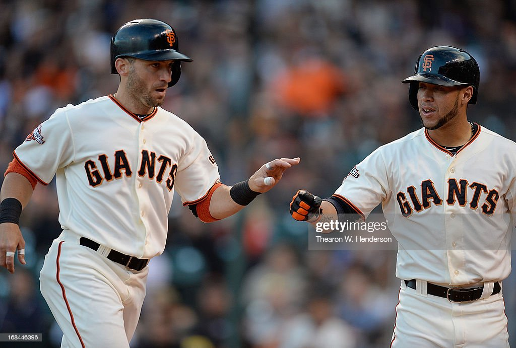 <a gi-track='captionPersonalityLinkClicked' href=/galleries/search?phrase=Marco+Scutaro&family=editorial&specificpeople=239523 ng-click='$event.stopPropagation()'>Marco Scutaro</a> #19 (L) of the San Francisco Giants is congratulated by <a gi-track='captionPersonalityLinkClicked' href=/galleries/search?phrase=Gregor+Blanco&family=editorial&specificpeople=4137600 ng-click='$event.stopPropagation()'>Gregor Blanco</a> #7 (R) after Scutaro scored against the Atlanta Braves in the first inning at AT&T Park on May 9, 2013 in San Francisco, California.
