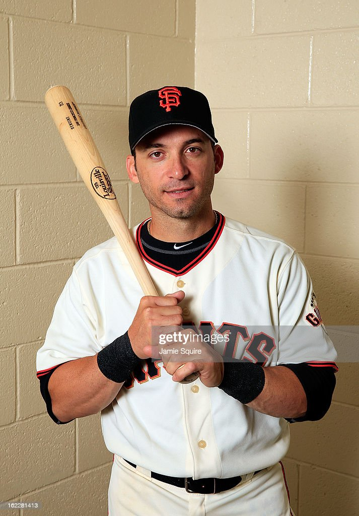 <a gi-track='captionPersonalityLinkClicked' href=/galleries/search?phrase=Marco+Scutaro&family=editorial&specificpeople=239523 ng-click='$event.stopPropagation()'>Marco Scutaro</a> #19 poses for a portrait during San Francisco Giants Photo Day on February 20, 2013 in Scottsdale, Arizona.