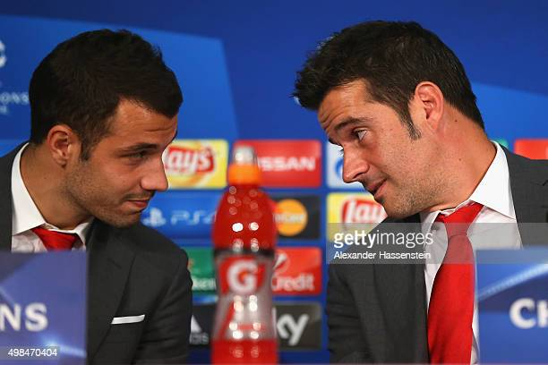 Marco Silva head coach of Olympiacos talks to his player Luka Milivojevic during a Olympiacos FC press conference on the eve of their UEFA Champions...