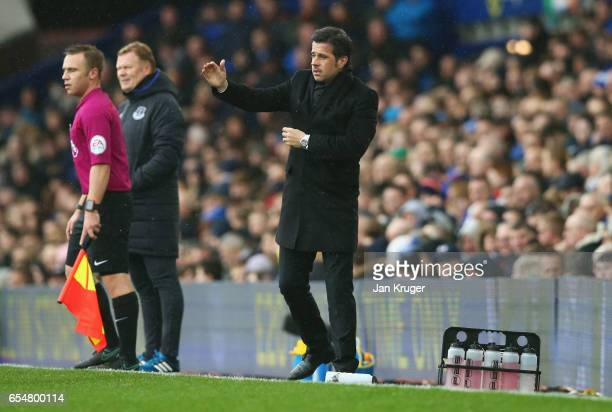 Marco Silva manager of Hull City signals as Ronald Koeman manager of Everton looks on during the Premier League match between Everton and Hull City...